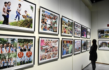 People visit smile face themed photography exhibition in Zunyi, China's Guizhou