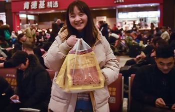Passengers bring gifts for families as they head home for Spring Festival