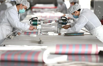 Workers make protective suits to power fight against epidemic in Hebei