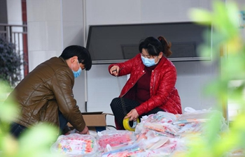 Study materials packed, delivered to students in Hubei to help with their self-learning at home amid epidemic