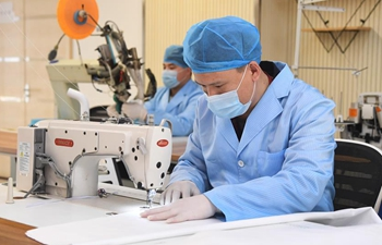 Company adds production line to make medical protective suits to support epidemic