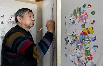 Artist in Tianjin busy producing New Year paintings as Spring Festival approaches