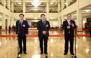 "In pics: deputies to 13th NPC receive ""passage interview"""