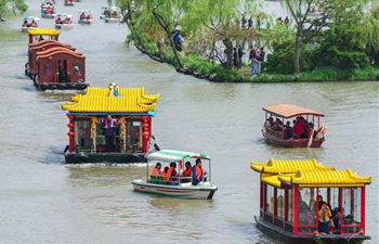Chinese people on trip during Qingming Festival holiday
