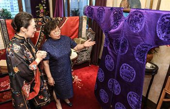 Exhibition of traditional costumes and embroidery artworks held in Beijing