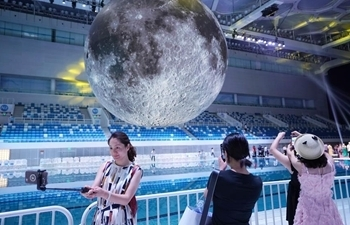 "Exhibition on China's Lunar Exploration Technology opens at ""Water Cube"" in Beijing"