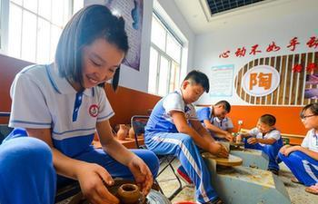 Traditional Chinese arts activities enrich students' summer vacation in China's Hebei