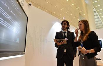 People experience high-tech at Summer Davos Forum