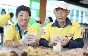 Local residents learn to make mooncakes in Gu'an County, N China's Hebei