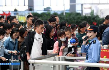 China's holiday to see peak in return trips on Sunday