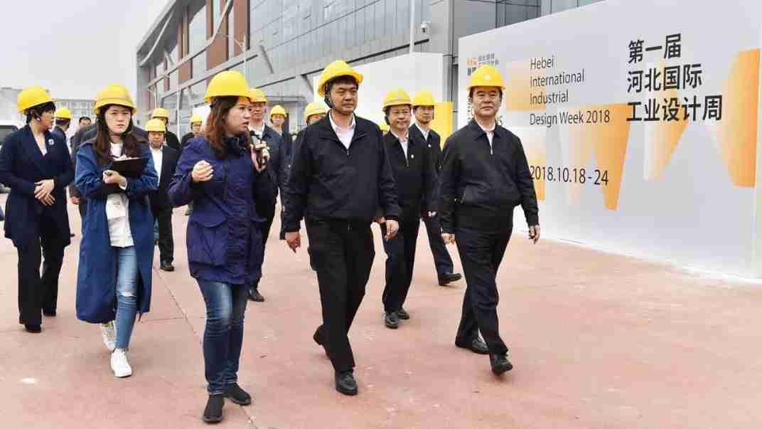 陈刚李谦调研国际工业设计周活动筹备工作
