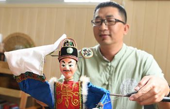 Intangible cultural heritage: perform puppets controled by iron sticks