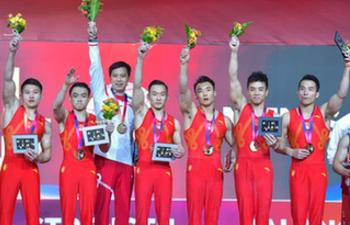 China wins men's team title at gymnastics worlds